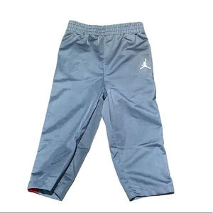 Air Jordan gray with red stripes pants 24 months